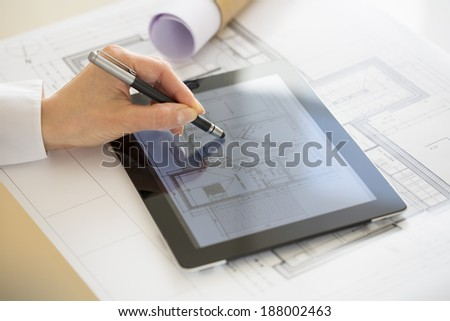 Close-up Of Hands Architect Woman Using Tablet Pc with Stylus - stock photo