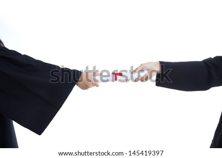 Close-up of hands giving graduation certificate on white background - stock photo