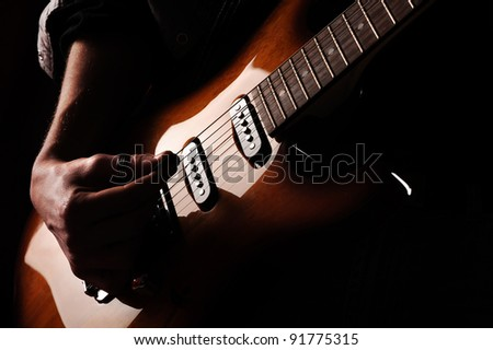 close up of hands guitarist - stock photo