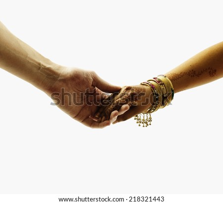 Close up of hands holding each other - stock photo