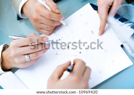 Close-up of hands of teamworking businesspeople on meeting at office. - stock photo