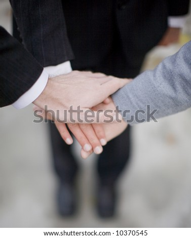 close-up of hands on top of each other - stock photo