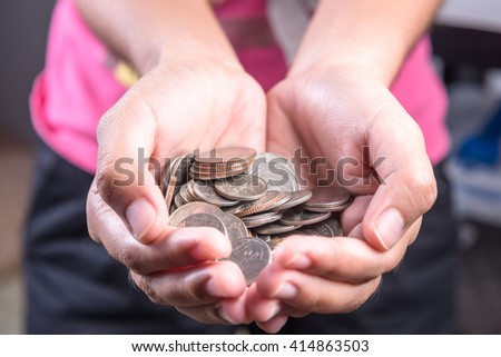 Close up of hands stacking coins on white background, Money growing concept, Save money with stack money coin for growing your business - stock photo