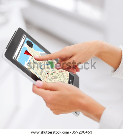 close up of hands with navigator map on tablet pc - stock photo