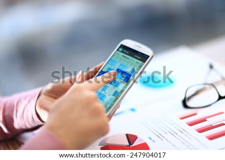 Close up of hands woman using her cell phone. indoor - stock photo