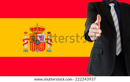 close up of handshake with spain flag - stock photo