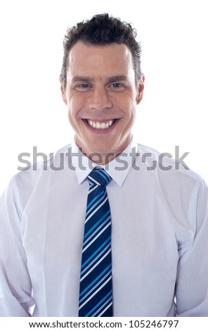 Close up of handsome male executive smiling at camera - stock photo