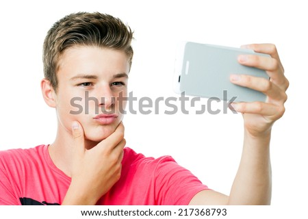 Close up of handsome Teen boy taking self portrait with smart phone.Isolated on white background. - stock photo