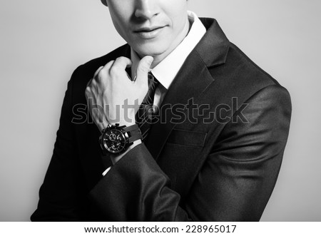 Close up of handsome unrecognizable man in a suit - stock photo