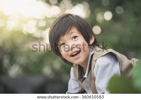 Close up of happy asian child outdoor,vintage filter - stock photo