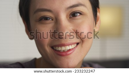 Close up of Happy Asian woman's face - stock photo