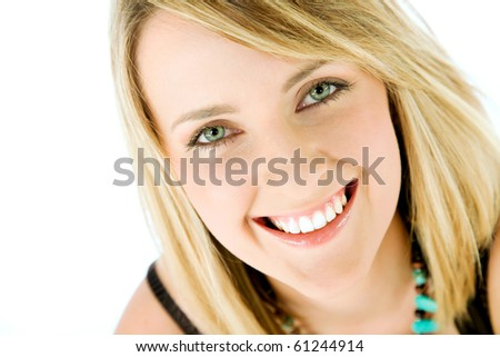 Close-up of happy blond female face smiling, looking at camera, isolated - stock photo