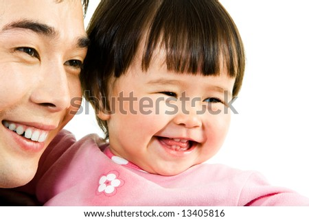 Close-up of happy father with daughter looking aside and laughing - stock photo