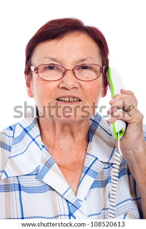 Close up of happy senior woman on the phone, isolated on white background. - stock photo