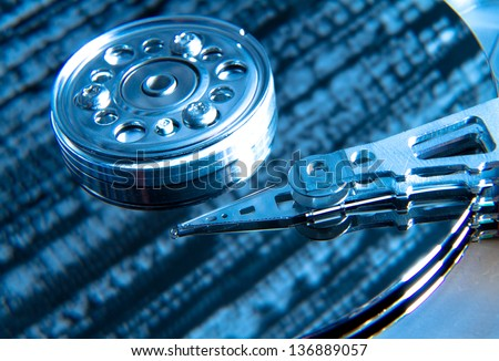 close up of hard disk with blue abstract technology reflection - stock photo