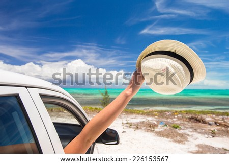 Close up of hat on white car at caribbean island - stock photo