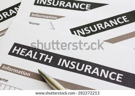 close up of health insurance form - stock photo