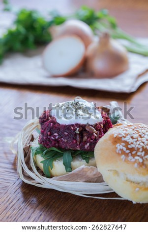 Close-up of healthy and tasty veggie beetroot burger - stock photo