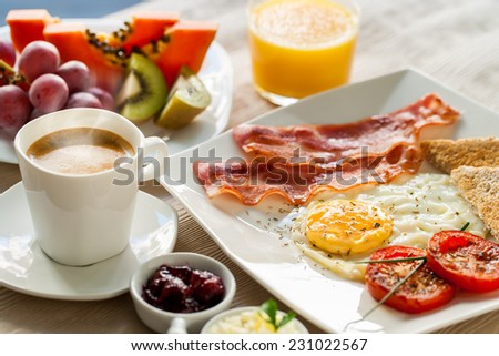 Close up of healthy continental breakfast with fresh fruit and ground coffee. - stock photo