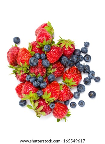 Close up of heap of strawberry and bilberry, isolated on white. Concept of healthy eating and dieting lifestyle - stock photo