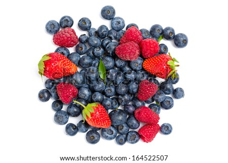 Close up of heap of strawberry, bilberry and raspberry, isolated on white background. Concept of healthy eating and dieting lifestyle - stock photo