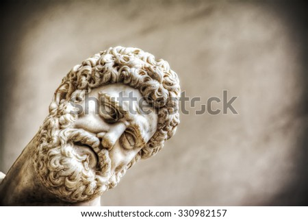 close up of Hercules face in Hercules and Nesso centaur statue in Florence, Italy - stock photo