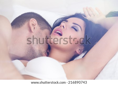 close up of heterosexual couple having sex - stock photo
