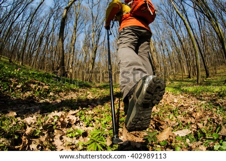 Close up of hiker shoes boots and hiking sticks poles - stock photo