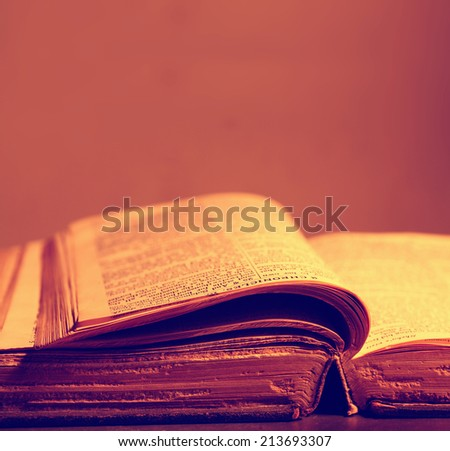 Close up of history old book in library - stock photo