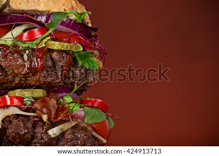 Close-up of home made tasty big burger on wooden table. - stock photo