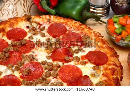 close up of homemade sausage and peperoni pizza - stock photo