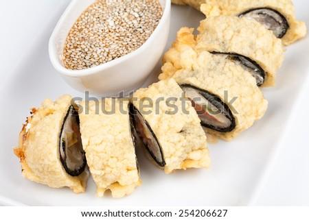 Close-up of Hot tempura sushi roll with tuna and salmon. - stock photo