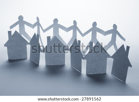 close up of houses and people cut out of paper on white background - stock photo