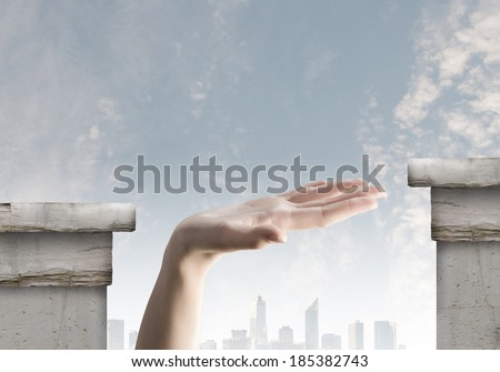 Close up of human hand between bridge gap - stock photo