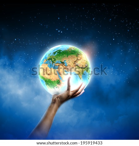 Close up of human hand holding Earth planet. Elements of this image are furnished by NASA - stock photo
