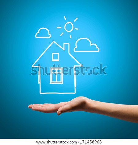 Close up of human hand holding house model - stock photo