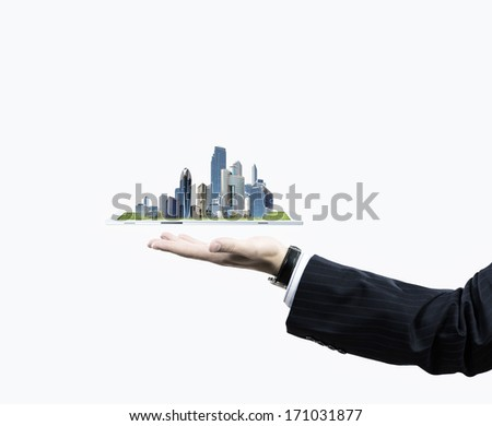 Close up of human hand holding tablet pc with city image - stock photo