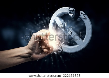 Close up of human hand touching prohibition sign - stock photo