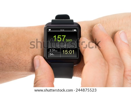 Close-up Of Human Hand Wearing Smartwatch Showing Heartbeat Rate Over White Background - stock photo