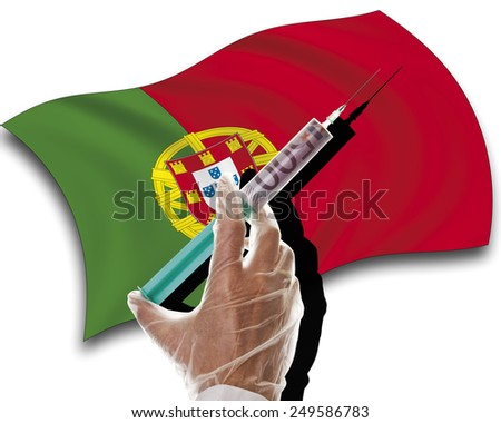Close up of human hand with cash injection on portuguese flag - stock photo