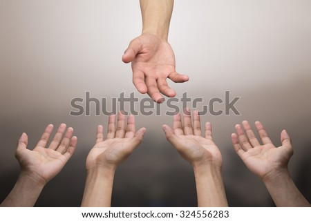 close up of human hands praying for helping:hand of god blessing and help to all pray.abstract helping hand over sepia vintage tone colors backgrounds concept.helping hands concept:religion concept. - stock photo