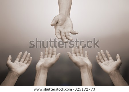 close up of human hands praying for helping:hand of god blessing and help to all pray.picture in sepia vintage tone colors backgrounds concept.helping hands concept:religion concept.halloween concept. - stock photo