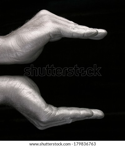 close-up of human hands represent a form of bowls or flower on black background, side view studio - stock photo