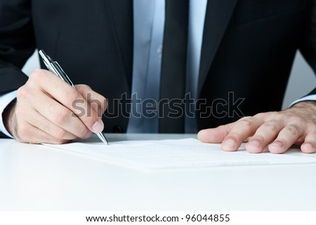 Close up of human hands signing a contract - stock photo