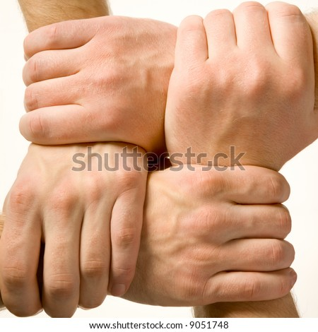 Close-up of human hands touching each other over white background - stock photo