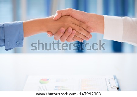 Close-up of human handshaking after successful collaboration - stock photo