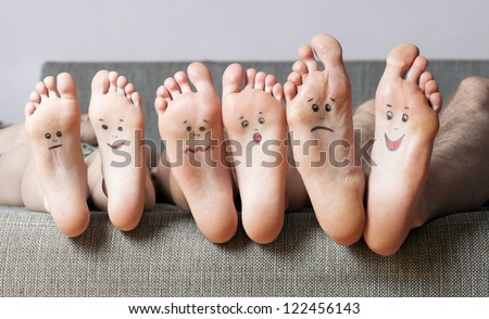 Close up of human soles with smiles - stock photo