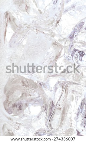Close up of ice cubes in water or soda - stock photo