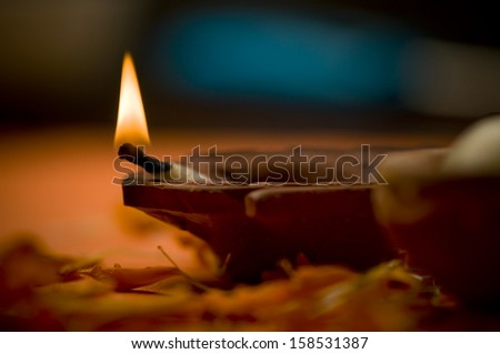 Close up of indian earthen oil lamp - stock photo