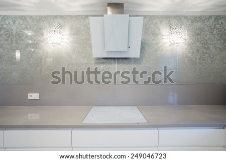 Close-up of induction hob in designer kitchen - stock photo